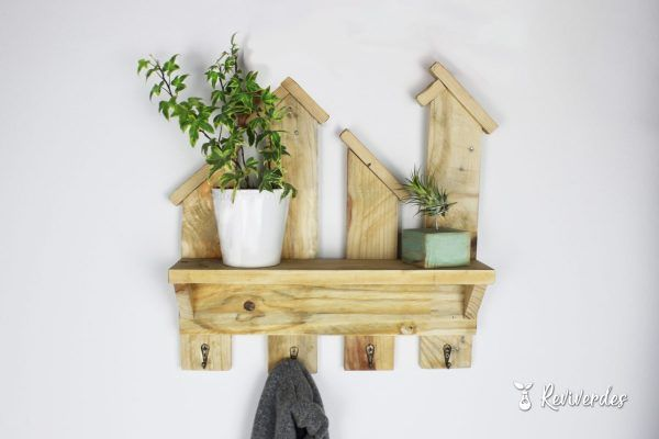 Wooden hanger with flower pots on the shelf