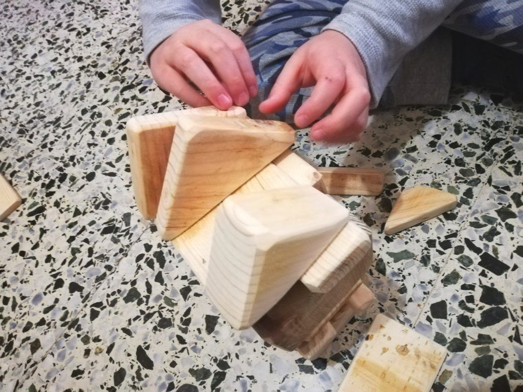 Boy playing with wooden game